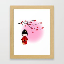 Japanese kokeshi doll at sakura blossoms Framed Art Print
