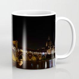Night photography of the Ponte Coperto of Pavia, historical building also called Ponte Vecchio built Coffee Mug