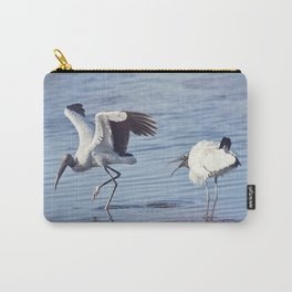 Two  wood storks fighting in a lake Carry-All Pouch