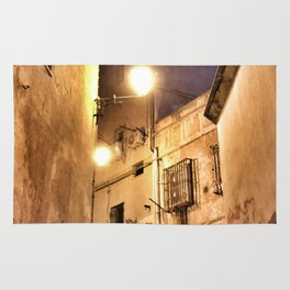 Narrow road at night with graffiti Rug