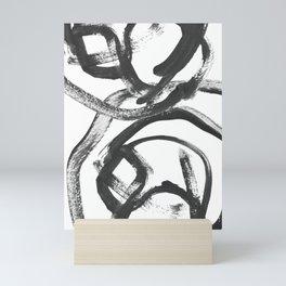 Interlock black and white paint swirls Mini Art Print