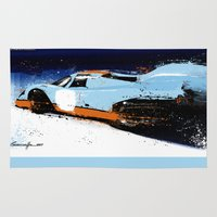 porsche Area & Throw Rugs featuring PORSCHE 917 -  by Michele Leonello