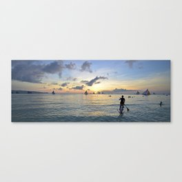 Paddle boarding into the sunset.  Canvas Print