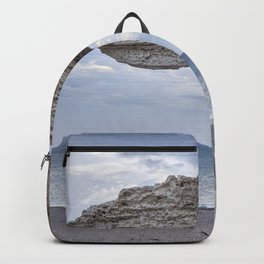 Arch Beach. At sunrise Backpack