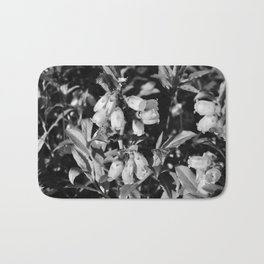 Tiny Blossoms On A Dirt Road in Black and White Bath Mat
