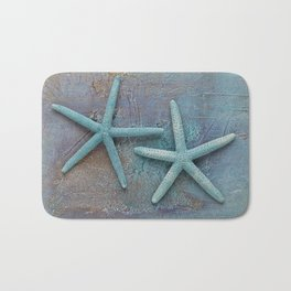 Turquoise Starfish on textured Background Bath Mat