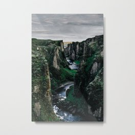 Fast flowing river making (wending) it's way between two massive rock formations Metal Print