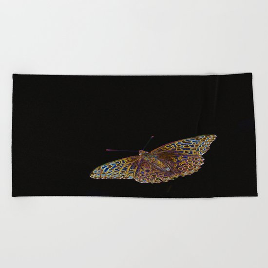 Butterfly on a black background Beach Towel