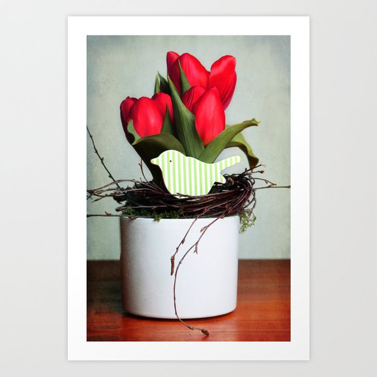 three tulips and a wooden bird Art Print