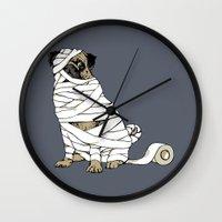 return Wall Clocks featuring The Mummy Pug Return by Huebucket