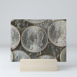 Morgan silver dollars in a pile Mini Art Print