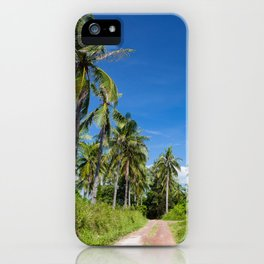 Road with palm trees and clear blue sky iPhone Case