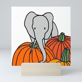 Big Elephant hanging out in the Pumpkin Patch for Halloween Mini Art Print