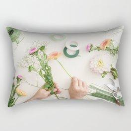 Man arranging flowers Rectangular Pillow