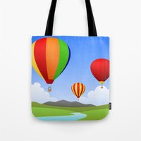 hot air balloons Tote Bags featuring Hot Air Balloons by Henry Meadowlark