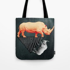 The orange rhinoceros who wanted to become a zebra Tote Bag
