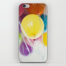 Bunch of pastel colored balloons flying in the air iPhone Skin