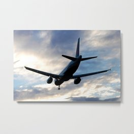 Airliner Landing at Sunset Metal Print