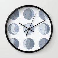 moon phases Wall Clocks featuring Moon Phases by Katie Boland