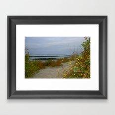 An evening walk along the Beach Framed Art Print