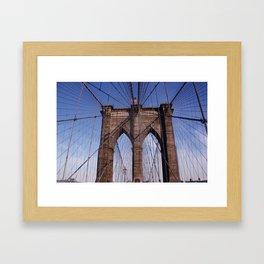 Brooklyn Bridge, the American flag and blue skies Framed Art Print