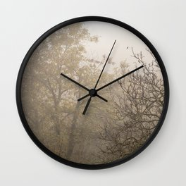 Autumnal naked trees surrounded by fog Wall Clock