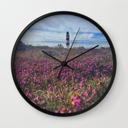 Lighthouse in field of heather Wall Clock