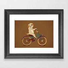 Puppy on the bike Framed Art Print