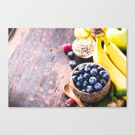 Close-up of fresh fruits and seeds in wooden tray Canvas Print