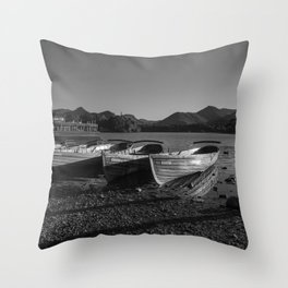 a black and white image of rowing boats moored at derwentwater Throw Pillow