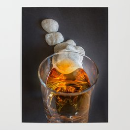 Whisky in one glass lying on small rocks on dark background from above Poster
