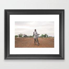Girl on a bike Framed Art Print