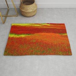 Crimson, Jade & Marmalade field of Orange and Red Flowers blooming in spring Rug