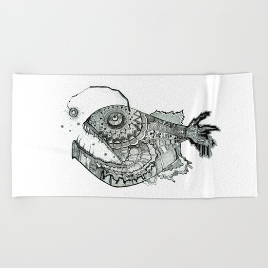 the iron fish Beach Towel