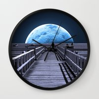 bruce springsteen Wall Clocks featuring Once in a blue moon by Donuts