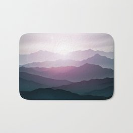 dark blue mountain landscape with fog and a sunrise and sunset Bath Mat
