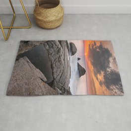 Orange sunset by the sea Rug