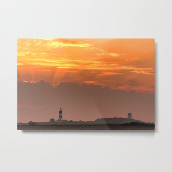Sun rays over Happisburgh Metal Print
