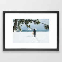Lone Korean surfer heads out for a wave after a huge snow storm on the 38th Parallel, South Korea Framed Art Print