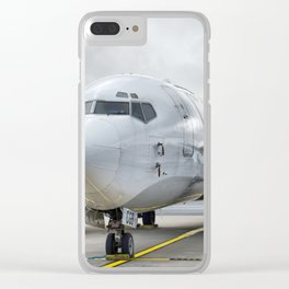 The plane at the airport on road Clear iPhone Case