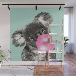 Playful Koala Bear with Bubble Gum in Green Wall Mural