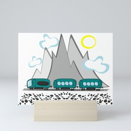 Train travel along the sea and mountains Mini Art Print