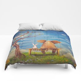 Elephant and rabbit sit on a bench on the glade Comforters