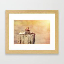 Balanced stone cairn in sunset light Framed Art Print