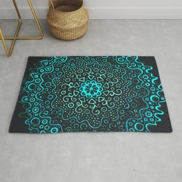 Turquoise mandala in the dark Rug