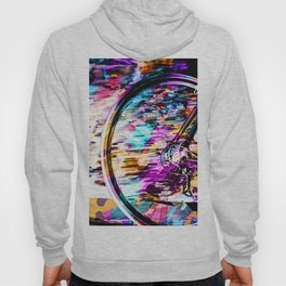 bicycle wheel with colorful abstract background in pink blue orange Hoody