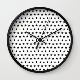 Black stars pattern with single golden star on white Wall Clock