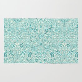 Detailed Floral Pattern in Teal and Cream Rug