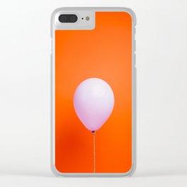 Purple balloon on orange backdrop Clear iPhone Case