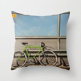 Green Bike on a Bridge Throw Pillow